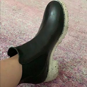 Black ankle boots with spotted thick rubber sole